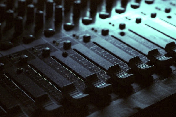 Close up of mixing desk with sliders